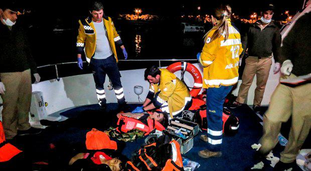 Rescuers try to revive a person after a boat carrying refugees sank off on its way to Lesbos Island at Ayvacik district, Canakkale on March 10, 2016