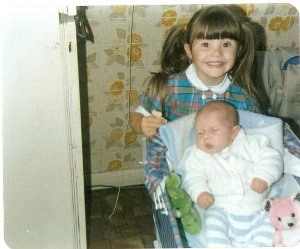 Michelle pictured with her brother Derek when they were children. Photo Credit: www.needsnotwantsblog.com