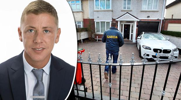 Gardai at the home of Jonathan Dowdall (inset)