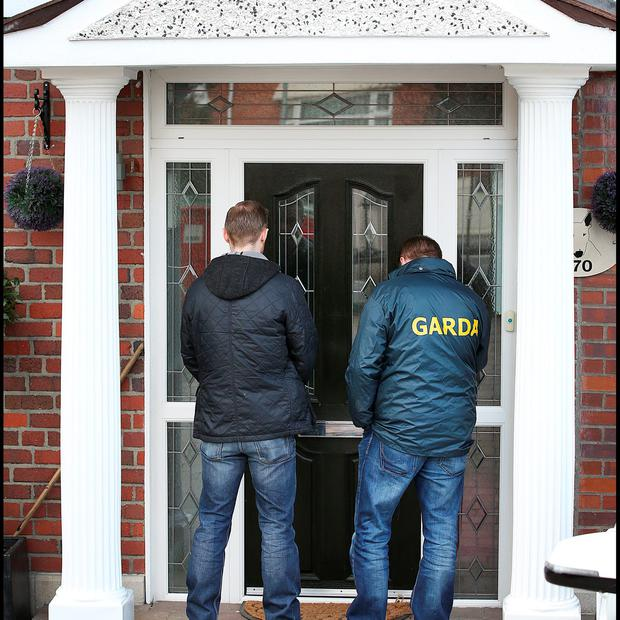 Gardai at the home on Navan Road earlier today.