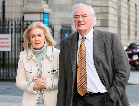 Dermot P. McArdle and his wife Margo, of The Pine Trees, Kilgobbin Road, Stepaside, Dublin pictured leaving the Four Courts during their Circuit Civil Court dispute with their neighbours, Colin and Jelena Kilgannon of Sans Souci, Kilgobbin Road, Stepaside, Dublin. Photo: Collins Courts