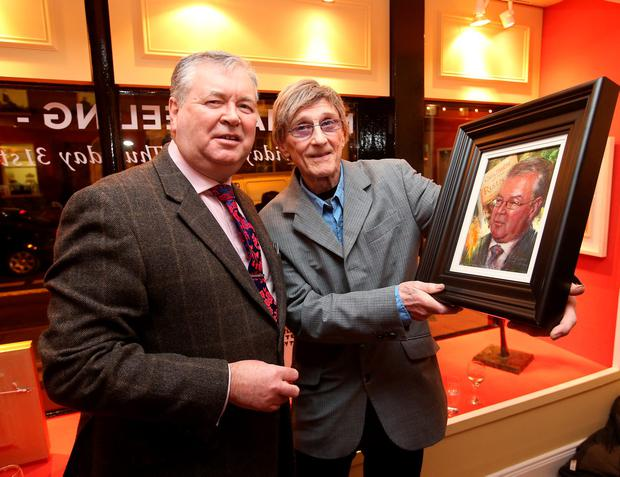 Artist, Norman Teeling presents a portrait to Joe Duffy, RTE broadcasster and author at the opening of The Rising, an exhibition of paintings at the Oriel Gallery on Clare Street. Picture credit; Damien Eagers