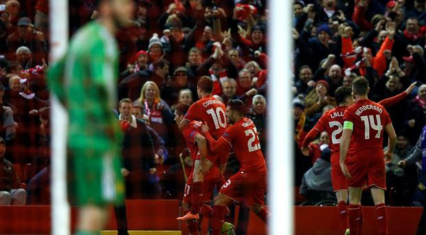 Roberto Firmino celebrates with teammates after scoring his sides second goal
