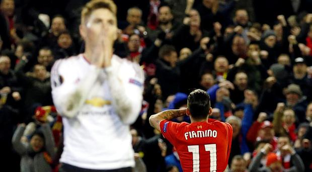 Football Soccer - Liverpool v Manchester United - UEFA Europa League Round of 16 First Leg - Anfield, Liverpool, England - 10/3/16 Roberto Firmino celebrates after scoring the second goal for Liverpool as Manchester United players look dejected Reuters / Phil Noble Livepic EDITORIAL USE ONLY.