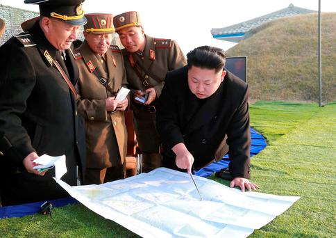 North Korean leader Kim Jong-un speaks with his generals. Photo: Reuters