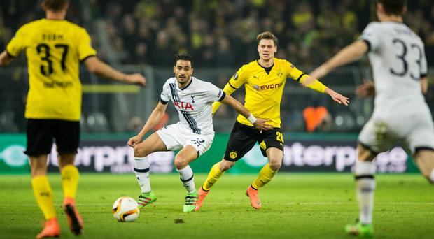 Lukas Piszczek of Dortmund is challenged by Nacer Chadli of Tottenham (Getty Images)