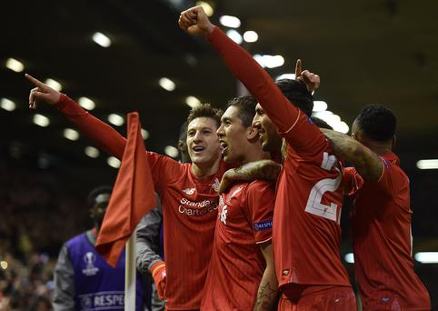 Roberto Firmino of Liverpool is congratulated after his goal (Getty Images)