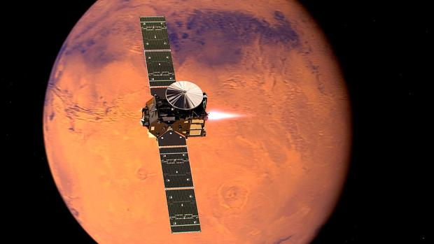 Undated handout photo issued by the European Space Agency of an artist's impression of the ExoMars 2016 Trace Gas Orbiter entering orbit