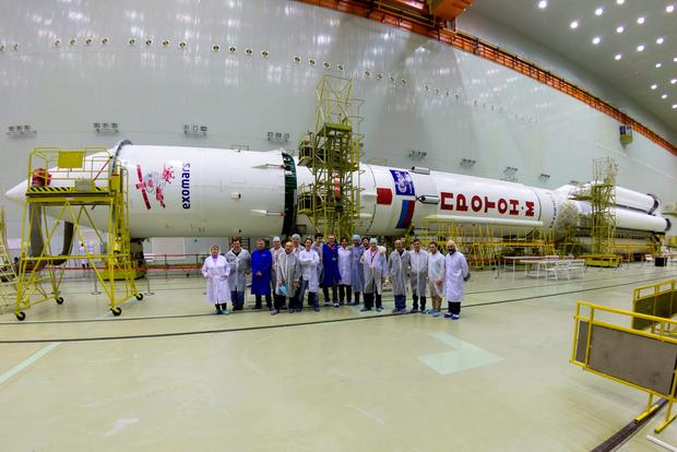 Undated handout photo issued by the European Space Agency of the ExoMars 2016 team in front of the proton rocket