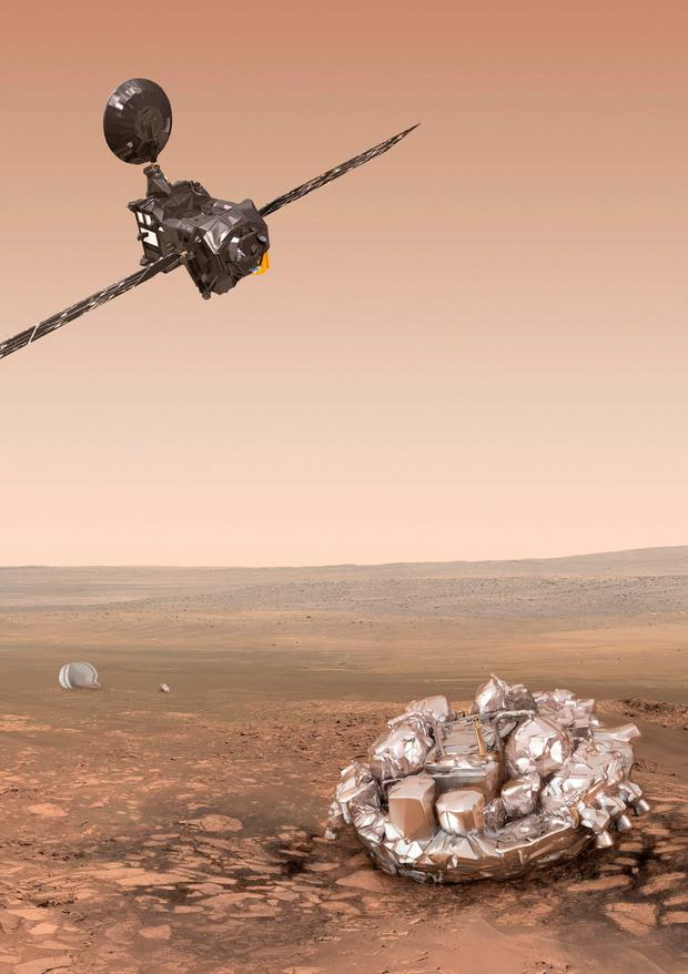 Undated handout photo issued by the European Space Agency of an artist's impression of the ExoMars 2016 Trace Gas Orbiter (top left) and Schiaparelli (bottom right) after discarding it's heatshields and parachute