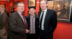 The Rising, an exhibition by artist Norman Teeling at the Oriel Gallery. L to R: Joe Duffy, Brush Shiels and INM Editor in Chief Stephen Rae.