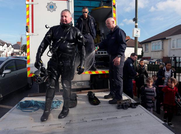 Members of the garda water unit outside the home of Jonathan Dowdall on the Navan Road. Picture credit; Damien Eagers