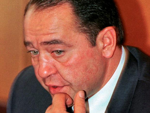 Former Russian Media Minister Mikhail Lesin gestures during a news conference in Moscow in this September 20, 2000 file photo