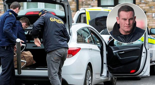 Gardai at the scene of one of the raids this morning. Inset, Eoin 'Scarface' O'Connor