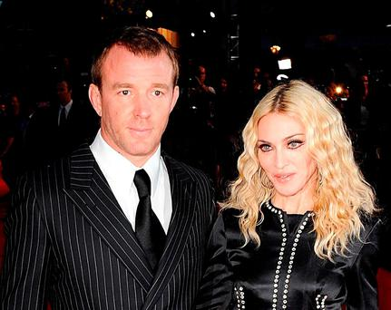 Guy Ritchie and Madonna, who are embroiled in a family court dispute in London relating to the future of their 15-year-old son Rocco Credit: Ian West/PA Wire