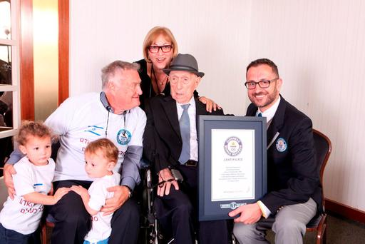 Guinness World Records handout photo of grandchildren Nevo (left)and Omer, Heim Kristal (son), Shula Kuperstoch (daughter) as Marco Frigatti, Head of Records for Guinness World Records, presents 112 year old Israel Kristal his certificate of achievement for being the world's oldest living man in Haifa, Israel Credit: Dvir Rosen/PA Wire