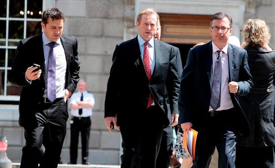 Enda Kenny is flanked by Feargal Purcell (left) and Mark Kennelly (right). Photo: Tom Burke