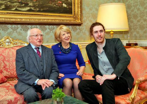 President Michael D Higgins and his wife Sabina with singer Hozier at Áras an Uachtaráin yesterday. Photo: Colin Keegan