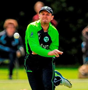 Ireland's Captain William Porterfield looks to hit the stumps after fielding the ball in the outfield. Photo: Seb Daly / Sportsfile
