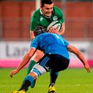 Ireland's Jacob Stockdale is tackled by Italy's Daniel Rimpelli during their Electric Ireland U20 Six Nations clash in Donnybrook. Photo: Piaras Ó Mídheach / Sportsfile