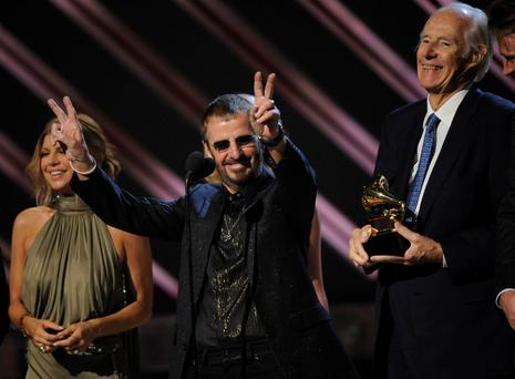 The late George Martin with Ringo Starr accepting an award in 2008. Photo: AP Photo/Kevork Djansezian