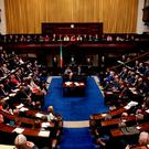 TDs take their seats in the Dáil. Photo: Maxwell's