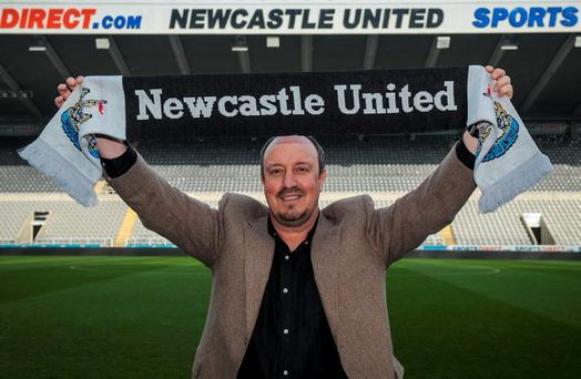 Rafa Benitez shows his new colours at St James' Park yesterday. Photo: Serena Taylor/Newcastle United via Getty Images