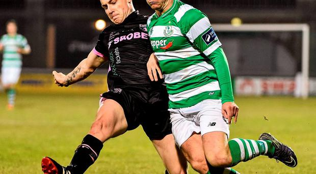 Wexford Youths' Aiden Friel attempts to tackle Shamrock Rovers' Dean Clarke. Photo: David Maher / Sportsfile