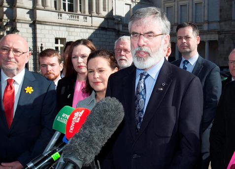 Sinn Fein party leader Gerry Adams with new Sinn Fein Dail members on the Plinth, Leinster House ahead of the first meeting of the 32ndDail. Photo: RollingNews.ie