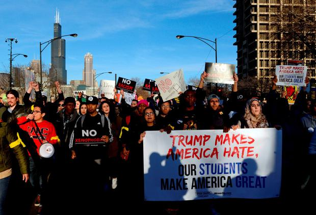 Protestors march in Chicago before the rally with Republican presidential candidate Donald Trump at the University of Illinois-Chicago. Photo: AP