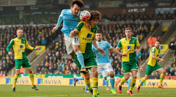 Manchester City's David Silva in action with Norwich City's Timm Klose Action Images via Reuters / Tony O'Brien