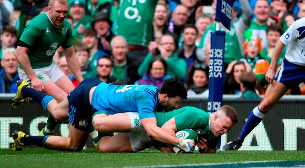 Ireland's Ian Madigan scores his side's eighth try during the 2016 RBS 6 Nations match at the Aviva Stadium
