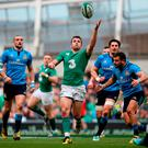Ireland's Jared Payne reaches for a high ball during the 2016 RBS 6 Nations match at the Aviva Stadium, Dublin. Niall Carson/PA Wire