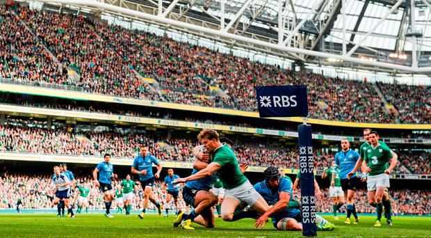12 March 2016; Andrew Trimble, Ireland, scores his side's first try of the game, despite the efforts of George Biagi, left, and Marco Fuser, Italy. RBS Six Nations Rugby Championship, Ireland v Italy. Aviva Stadium, Lansdowne Road, Dublin. Picture credit: Ramsey Cardy / SPORTSFILE