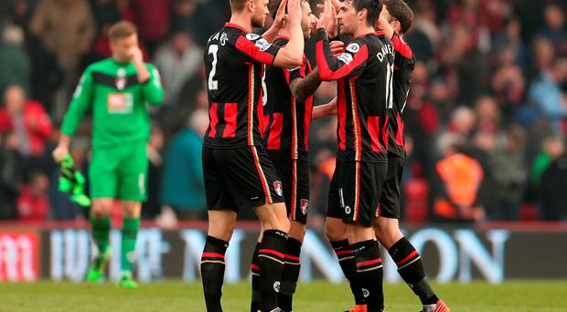 Bournemouth's Simon Francis and Charlie Daniels celebrate after the game Action Images via Reuters / Matthew Childs