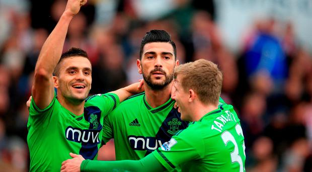 Southampton's Graziano Pelle (centre) celebrates scoring his side's second goal of the game with team-mates Dusan Tadic (left) and Matt Targett during the Barclays Premier League match at the Britannia Stadium