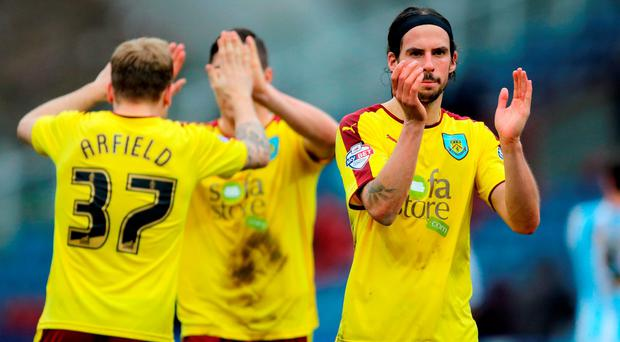 Burnley's George Boyd celebrates victory after the Sky Bet Championship match at the John Smith's Stadium