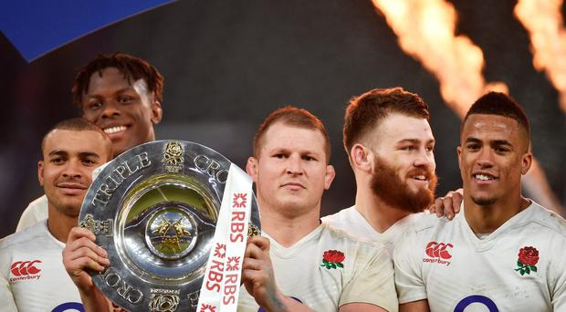 England's Dylan Hartley celebrates with the Triple Crown at the end of the match