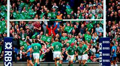 Ireland supporters celebrate as Sean Cronin of Ireland scores his team's seventh try. Photo: Getty
