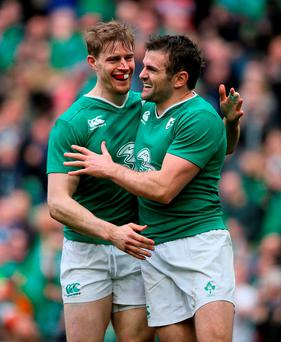 Ireland's Jared Payne (right) celebrates scoring his side's fifth try with Andrew Trimble. Photo: PA