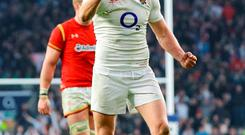 Owen Farrell celebrates England's victory over Wales which earned then the Triple Crown at Twickenham yesterday. Photo: PA