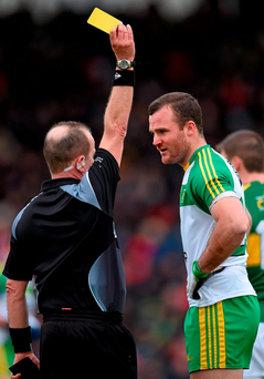 Neil McGee is shown a yellow card by Eddie Kinsella during last Sunday's bad-tempered clash between Kerry and Donegal Photo: Brendan Moran/SPORTSFILE