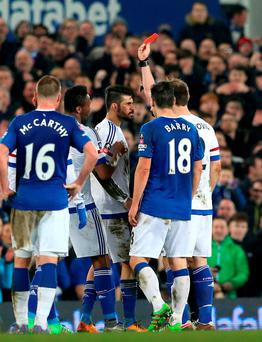 Chelsea's Diego Costa is shown the red card by referee Michael Oliver. Photo: PA