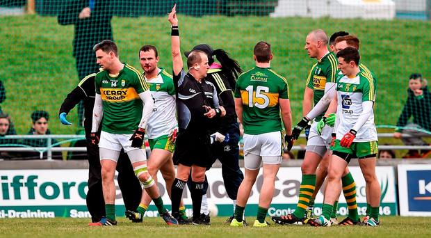 Alan Fitzgerald, Kerry, is shown a red card by Referee Eddie Kinsella after an incident with Neil McGee, Donegal. Picture credit: Brendan Moran / Sportsfile