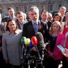 Blame game: Sinn Fein vice-president Mary Lou McDonald and Sinn Fein president Gerry Adams with elected candidates at Leinster House, Dublin. Photo: Gareth Chaney Collins