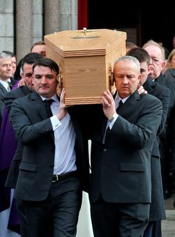The remains are carried from Church after Mass at the funeral of Supreme Court Judge, Adrian Hardiman. Photo: Colin Keegan, Collins Dublin