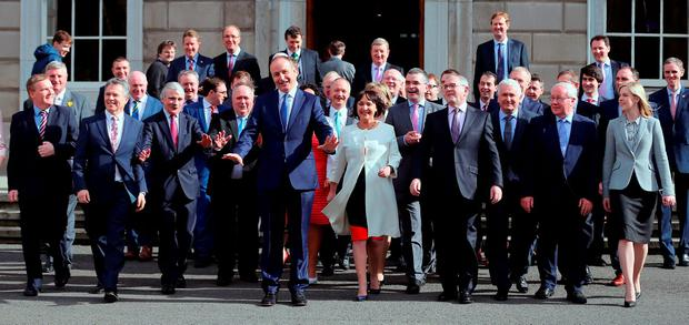 Back in business: Micheal Martin and his team of Fianna Fail TDs at Leinster House last week as they arrived for the first sitting of the new Dail. Photo: Niall Carson