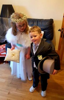 Rhys in his ring-bearer's outfit with his cousin Beth, who is the bride and groom's daughter