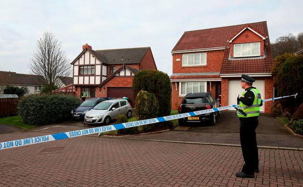 Police outside a house (left) in Dalgety Bay in Fife where two-year-old twin boys drowned after falling into a fish pond in a garden in Fife Credit: Andrew Milligan/PA Wire