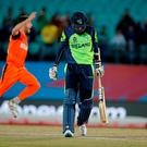 Ireland's George Dockrell walks back after he is bowled out during the ICC World Twenty20 2016 cricket tournament against Netherlands at the Himachal Pradesh Cricket Association (HPCA) stadium in Dharamsala, India, Sunday, March 13, 2016. (AP Photo /Ashwini Bhatia)